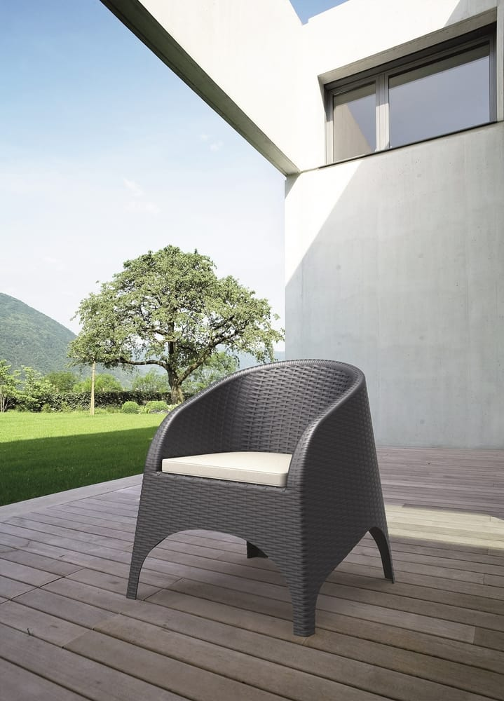 Outdoor armchair with cushion