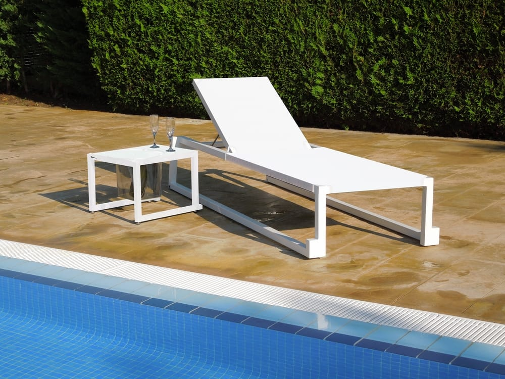 Sun lounger and low table