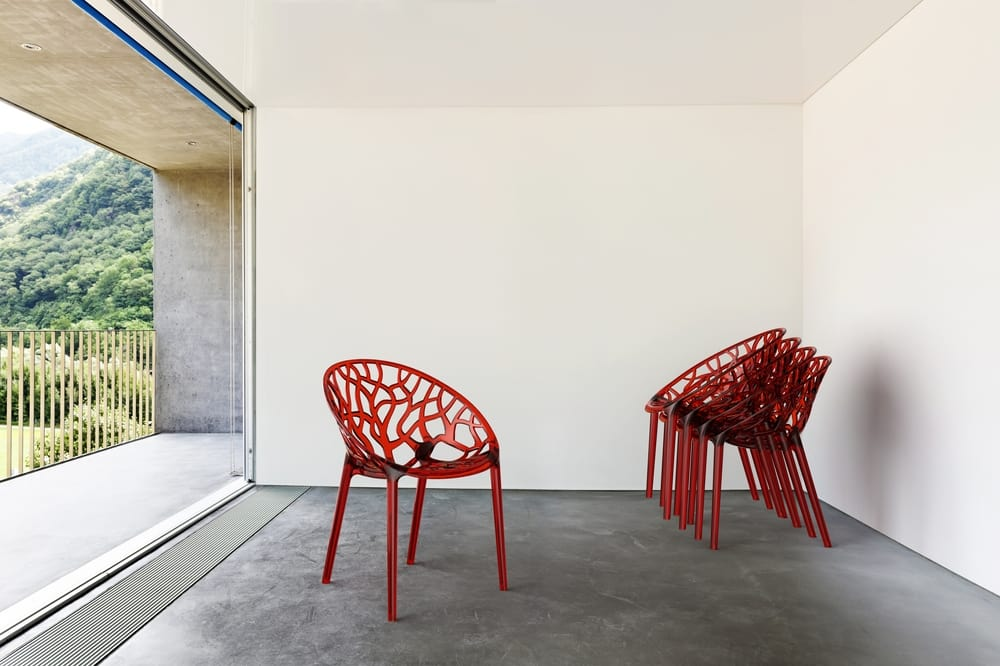 Stackable chairs in red polycarbonate