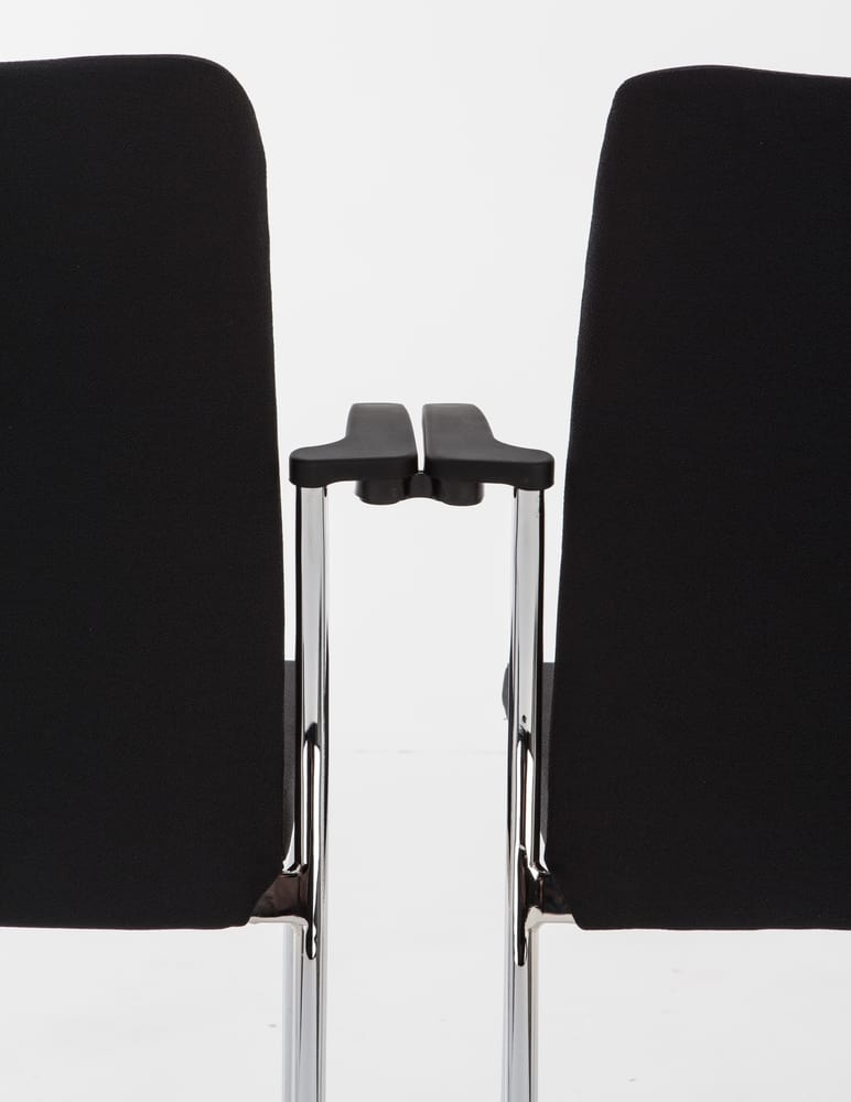 Linking system between armchairs