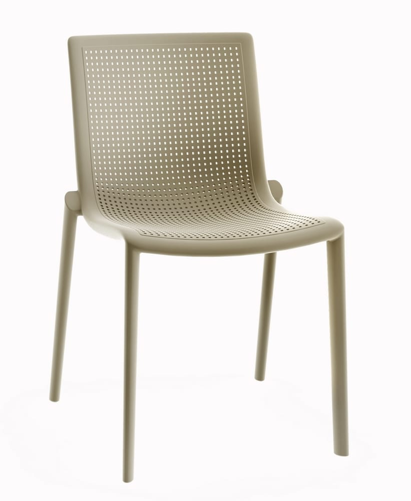Plastic chair with perforated shell