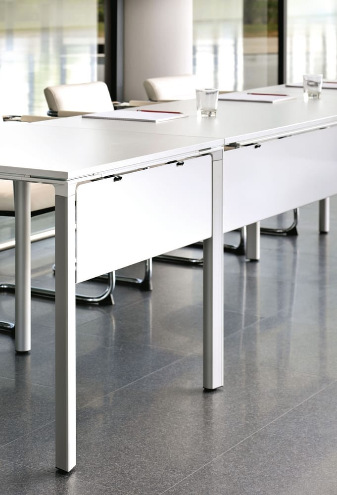 Tables with front modesty panels